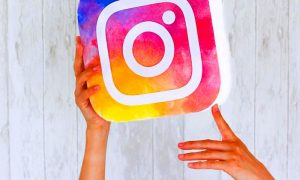 Instagram logo held in women hands